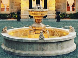 Hand carved rounded limestone pool fountain with urn