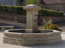 Hand carved octagonal limestone pool fountain