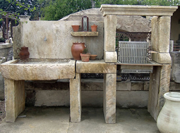 "Antique thick Limestone slabs milled at 3"" in thickness used as BBQ countertops and middle preparation table, salvaged from the bottom of farm house foundations"